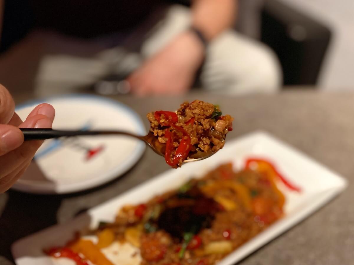 Thai stir-fry with pork (focused)